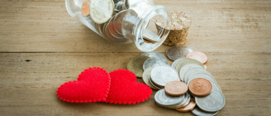 Red,Heart,And,Coin,On,The,Wooden,Table